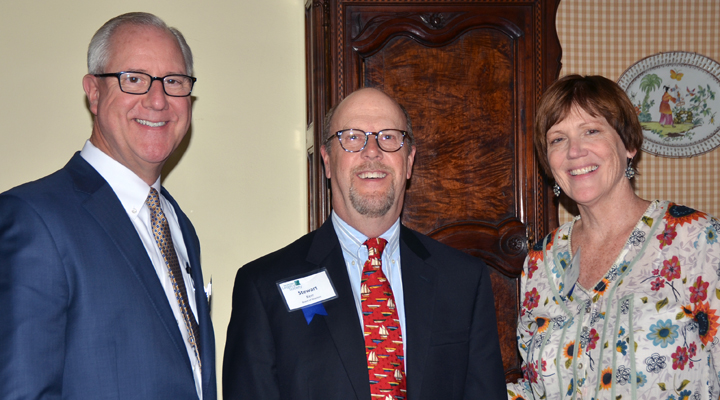 John Anderson, Stewart kerr, and Anne Reusche standing close together and smiling